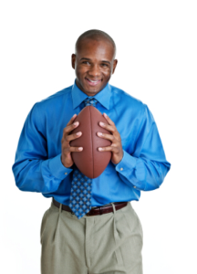 Coach holding football